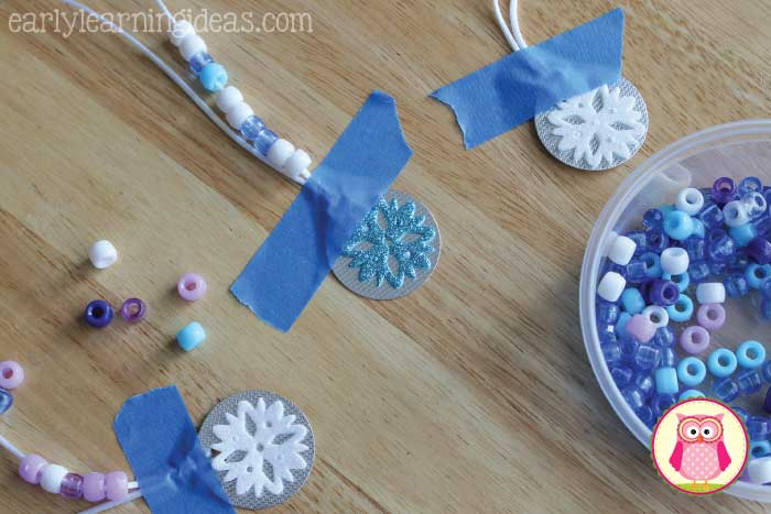 Kids will have so much fun making these fun snowflake counting necklaces, that they won't realize they are working on fine motor skills and math concepts. This is a great activity for your winter and snow themed centers in preschool, pre-k, and kindergarten. Your kids can work on counting to ten, patterning and many other math concepts.