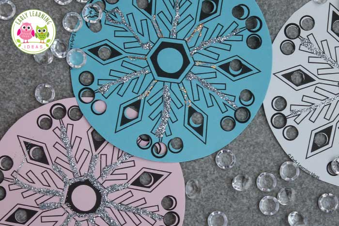 Check out this simple snowflake fine motor activity for your kids. Kiddos enjoy punching holes in these paper snowflakes. Download the free printable snowflakes today. Perfect for your winter theme, snow theme, or snowflake theme unit and lesson plans in preschool, pre-k, kindergarten, and OT. Add them to your fine motor center, or art and craft centers. Decorate a tree, decorate your classroom. Your kids will have so much fun with this. Ideas are included. #finemotor #winteractivitiesforkids