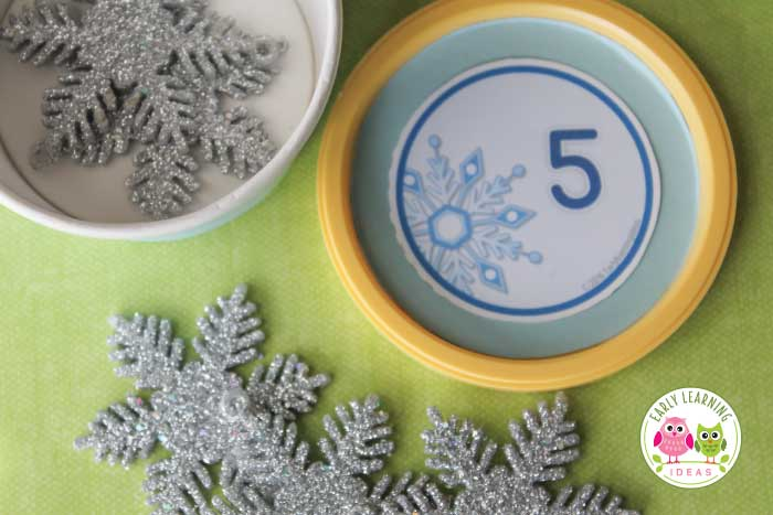 Looking for winter math activities for your kids? Try these snowflake number circles. Use the free math printables in muffin tins or use them to make counting containers. Many ideas are included for counting, number sense, and even basic addition. Perfect for your winter math centers or math work stations in preschool, pre-k, and kindergarten. A great addition to your snow theme, snowman theme, winter theme unit and lesson plans. #preschool #winteractivitiesforkids #preschoolmath