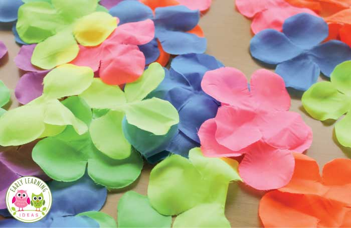 Here are a couple flower color sorting activities that you can make with a Hawaiian lei. Kids can work on color sorting, number sense, and patterning with these cute activity ideas. Perfect for your flowers theme, plant theme, spring theme, summer theme units and lesson plans. For your tot school, pre-k, and preschool class math centers or math work stations. teach colors, color sorting, color matching, flower activity ideas.