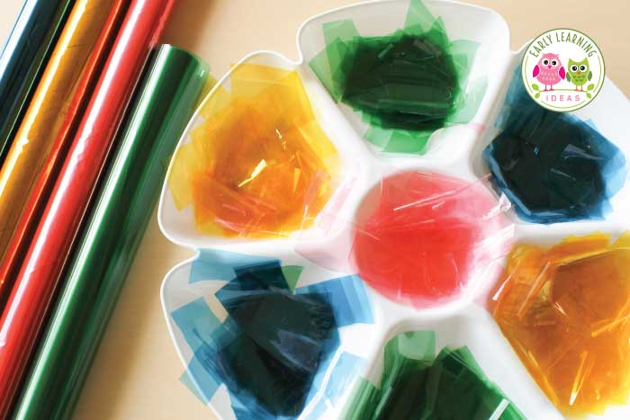 Your kids will be memorized by this cellophane stained glass craft. It's fun way to explore color with kids. Use this as a process art activity and fun way for teaching color mixing and transparency. It's a great sensory activity that can even be used on a light table in your preschool or pre-k classroom. Children will love to experiment while learning about colors (red, blue, yellow, green..), color mixing and the science of color.