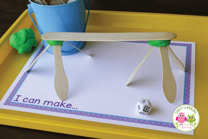 Here is a easy preschool counting and creating activity to make math fun. Use simple, on hand materials, along with the free printable for this fun preschool STEAM math and design activity. Add play dough for 3-D designs. Perfect for your hands on math centers in preschool, pre-k classroom. Ideas to make a number books or to use as a fine motor activity are included. Preschool math, preschool STEM, preschool STEAM. Get out the pom-poms and pipe cleaners for hands-on early childhood learning.