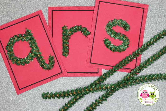 These red fluffy letters may look a little like they are made from pipe cleaners, but the material is a chenille ribbon.  Again, I used my awesome new glue gun to apply it to the card.