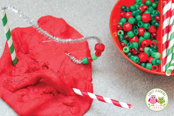 Your kids will love this sparkly homemade Christmas Playdough. Learn the secret ingredient & make your own DIY batch of this unique sensory play dough today. This is perfect for your Christmas theme and holiday theme fine motor and learning centers. Use with play dough mats, play dough tools, etc. Your kids will love how this tinsel play dough feels when they pull it apart.....so cool. #christmasactivities #playdough #playdoughrecipe #finemotor #preschool