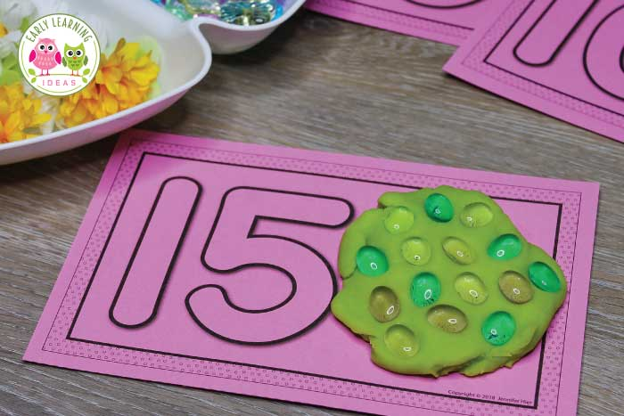 These 1-20 number playdough mats are a great multi-sensory way to teach early math skills to kids in preschool, pre-k, and kindergarten. While they are perfect for play dough, you can use them with pom-poms, small erasers or any type of loose parts. Teach math and work on fine motor skills at the same time....plus it's fun for kids. The mats come in a variety of styles...with or without ten frames. Coordinate them with your current theme or season. #preschool #preschoolmath #playdough