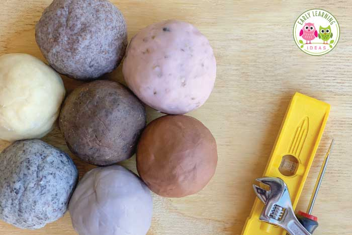 Make the best playdough for your construction theme sensory activities and learning centers in your preschool or pre-k classroom. Find directions to make brown, gray, and dirty playdough and many fun mix-in ideas to add interesting textures. The dirt playdough is perfect for construction theme or building theme math mats, playdough mats or play dough centers. You will love these dough recipes and ideas. Kids will work on fine motor skills while playing in their construction zone. #playdough