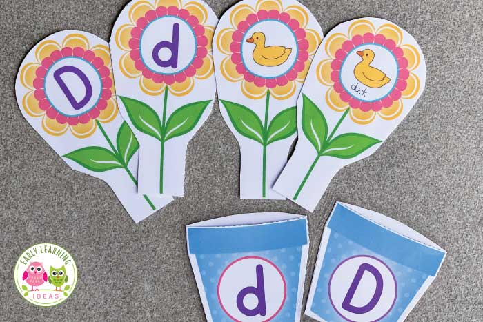 Your kids will love this hands-on flower them literacy activity. Use it to teach letters, letter recognition, letter sounds, beginning sounds and phonological awareness. The printables are perfect for a preschool and pre-k classroom - a perfect addition to your literacy centers for a flower theme, spring theme, garden theme or mothers day theme unit, and lesson plans. The printables are easily adapted for individual students..ideas are included. #preschoolactivities #alphabetactivities