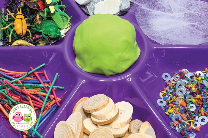 Create a bug themed playdough invitation to play with these material ideas. Your kids will have a blast with this activity. It's perfect for your bugs and insects theme, camping theme, outdoor theme, spring theme, summer theme units and lesson plans in a preschool or pre-k classroom. Kids can make bugs, create insect habitats. There are also ideas to add math and literacy learning activities to this play based learning center. Add ladybugs, spiders, bees, etc. #preschool #playdough