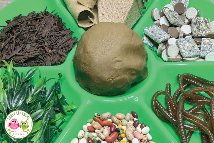 Make a plant theme playdough invitation to play. Here are lots of material ideas to make an exciting plant & garden theme playdough tray. This is a great hands-on fine motor and sensory activity for your garden theme, plants theme, spring theme, or Earth Day theme unit or lesson plans in your preschool or pre-k classroom. Kids will love planting plants and seeds in the brown playdough and will have opportunities for math and literacy learning as they create with worms. #preschool #playdough