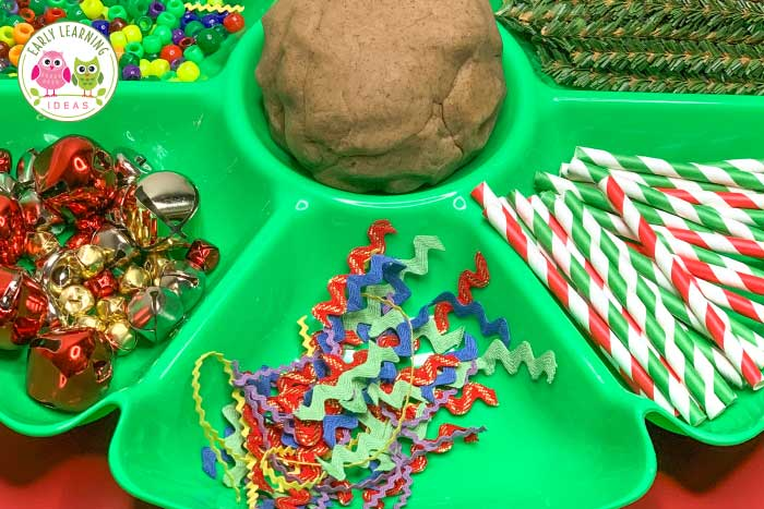 Find lots of ideas to help you easily make a gingerbread #playdough tray. Your kids will love using the materials to make fun gingerbread themed creations. This is a perfect open-ended and fine motor activity for your #preschool #prek classroom. Use for Christmas theme or gingerbread theme unit or lesson plans or with a study of the gingerbread man book. A fun fine motor activity with ideas for hands-on math and counting activities. #gingerbreadtheme #finemotoractivities