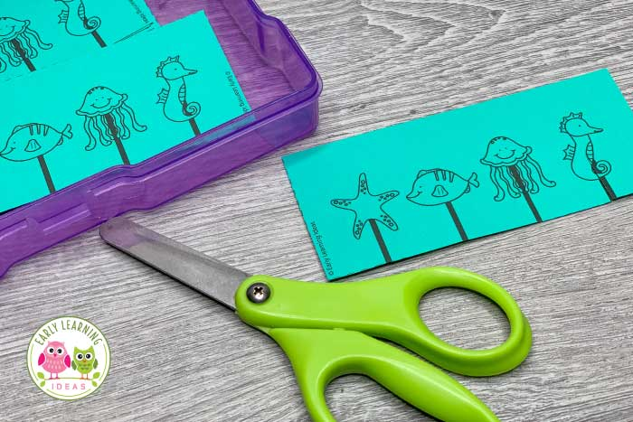 From snipping to cutting on a longer path, use these free ocean-themed printables to help your preschoolers work on scissor skills development. The fine motor printable includes a variety of pages for many skill levels. Start your kids with practice on single snips and work toward teaching them to cut on a variety of lines (from straight lines, curved paths, zig-zags, waves). Perfect for your preschool, pre-k, or occupational therapy classroom.