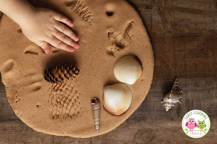 Use natural elements as playdough tools. From shells, rocks, and pinecones..... find lots of idea.