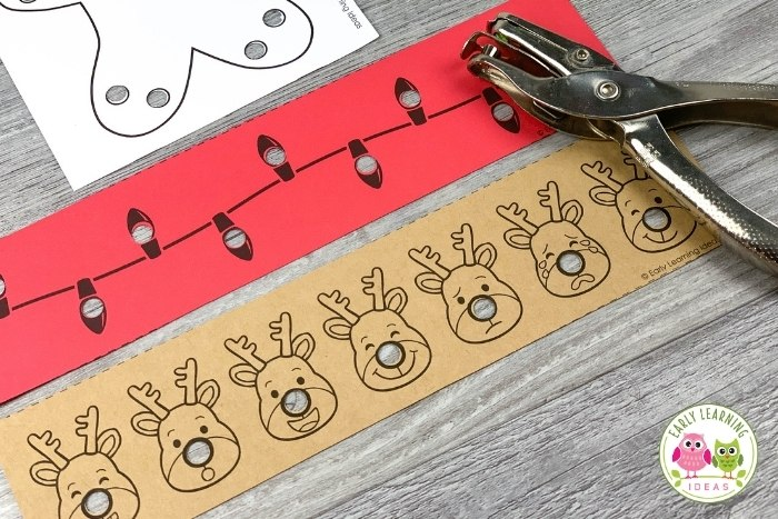 Christmas fine motor hole punch strips in reindeer and light strand theme