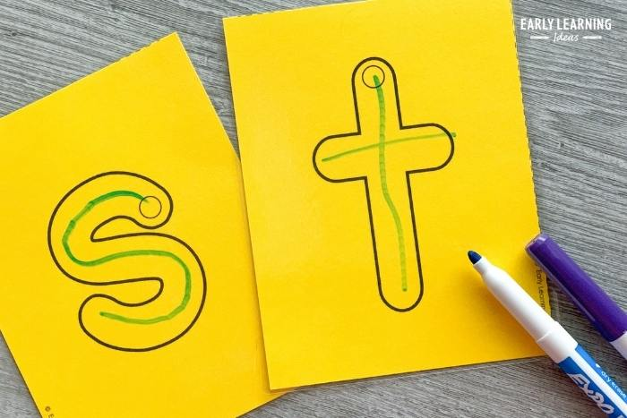 Dry-erase markers to trace letters on letter cards
