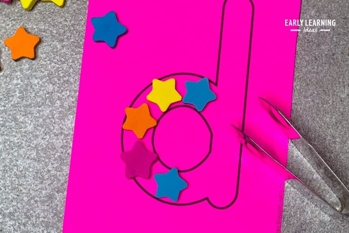 placing mini erasers on letter cards