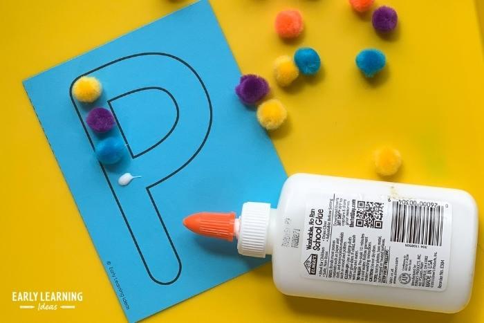 glue craft pom-poms to letters