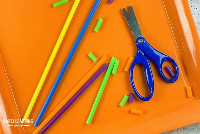 Kids can practice scissor skills by cutting straws