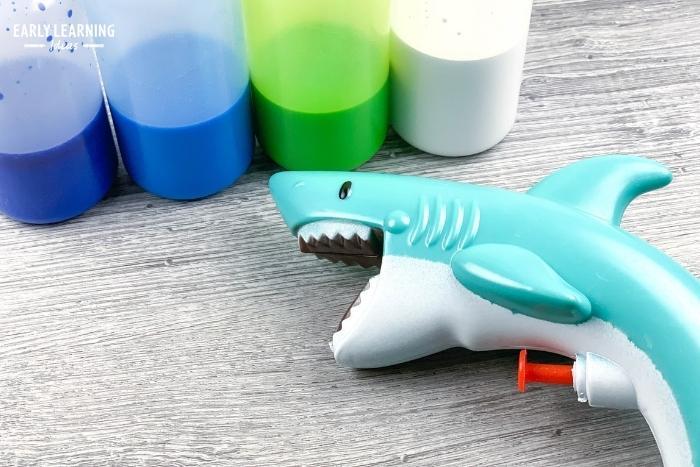 Use a water gun or squirt gun to help kids build hand strength