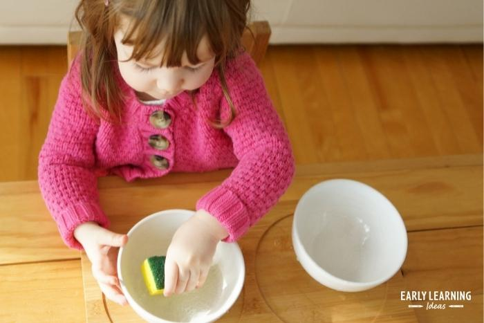 squeezing sponges and wash clothes will help kids develop hand strength