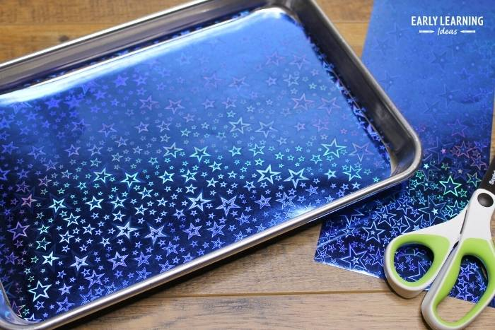 Add fancy scrapbook paper to the bottom of the salt tray to add excitement